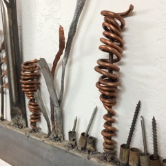 Detail of copper, nails, 9mm bullet casings, hammered steel, brushed pipe